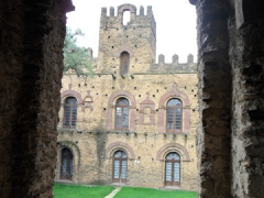 Archway view of a castle in Gondar's Royal Enclosure
