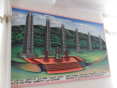 A poster of King Remhai of Axum with his massive steles in the background; Remhai Hotel