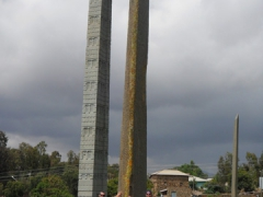 Robby and Lucky are dwarfed by the massive obelisks of the May Hedja Stele Park; Axum