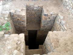 View of the the Catacombs of Gebre Meskal, in a cross shaped pit; Axum
