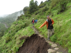 Robby crosses a narrow footpath; Simien Mountains