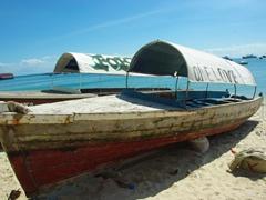 """One Love"" dhow on a beach in Stone Town; Zanzibar"