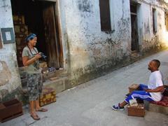 Becky and a friendly craftsman joke around in Stone Town; Zanzibar
