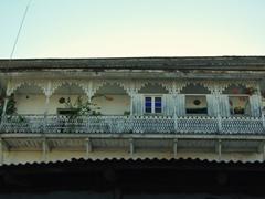 A quaint balcony looks over the labyrinth maze of Stone Town; Zanzibar