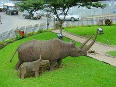 A rhino statue at a Tanzanian traffic circle
