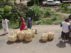 Baskets full of produce for sale; Dar Es Salaam market