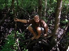 Robby poses atop some mangrove roots; Jozani Chwaka Bay National Park