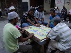 Zanzibaris playing dominoes at Jaw's Corner; Stone Town