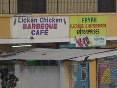"""Sign board of """"Licken Chicken Barbeque Cafe""""; Dar Es Salaam"""