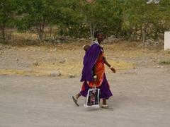 A Maasai woman walking down the street; Lake Manyara