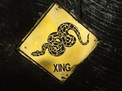 Snake Crossing signpost; Arusha Snake Park