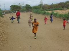 "The children come a-running when they spot the ""mzungus""; Maasai village walk"