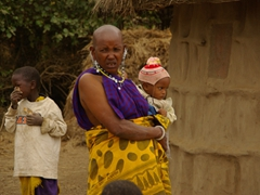An elderly Maasai woman watches over the children; Arusha