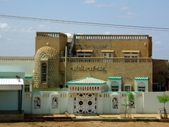 A highly decorated house catches our eye on the drive in towards Khartoum