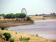 A Ferris wheel by the Blue Nile River