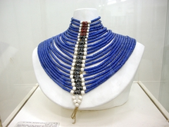 Showcase piece of a man's bead collar made of blue hexagonal and black spotted Venetian beads; Ethnographic Museum