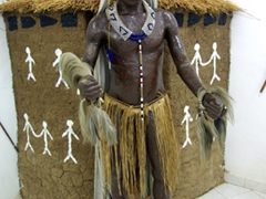 Costume of a traditional Kambala Dancer (with buffalo horns on his head, a string of blue glass beads worn around his neck, and a belt of palm fiber worn around the hip of the dancer); Ethnographic Museum