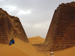 A security guard keeps an eye on us to ensure that no one violates the Nubian Pyramids in any way; Meroe Pyramid Complex
