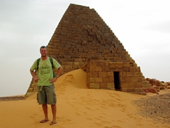 Robby strikes a pose in front of a diminutively sized Nubian Pyramid