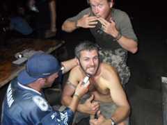 "Lucky gives Robby a ""special"" shave while Lars looks on in approval; Sudan bush camp"