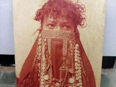 Photo of a female member of the Rashaida Arab Tribe. The veil is a special element of the bridal dress and is only worn for festive occasions; Ethnographic Museum of Khartoum