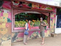 Ichiyo and Robby strike a pose outside a juice stand; Khartoum