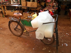 An ice seller rides around the Omdurman Souq selling highly coveted chunks of ice to the highest bidders
