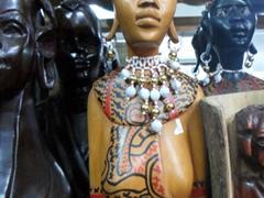 Wooden bust of a Maasai woman for sale; Omdurman Souq