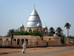 A local strolls past the Mahdi's Tomb (the Mahdi was a popular religious leader who led successful rebellions against the Turco-Egyptian government of Sudan in the 1880s); Khartoum