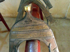 Detail of a wooden and brass horse saddle; Khalifa's House in Khartoum