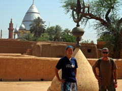 Posing in Khalifa's House (with the Mahdi Tomb visible in the background); Khartoum