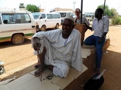 Portrait of a devout taxi van driver; Khartoum