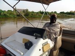 Kamal commandeering his boat; Blue Nile River