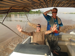 Robby clowns around while Lars gazes off in the horizon; Blue Nile River in Khartoum
