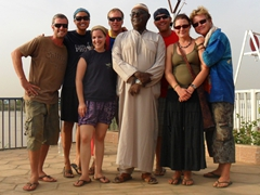 Robby, Becky, Ally, Matt, Kamal, Lucky, Marie and Lars grin happily after their Blue Nile River excursion