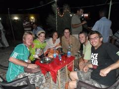Lars, Ally, Ichiyo, Marie, Robby and Dowelly prepare to enjoy a shisha/hookah pipe; Wadi Halfa