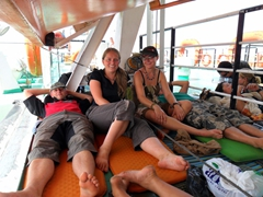 Cramped quarters under the lifeboat (Damien, Anna, Marie and Lars are all snug as a bug on the Wadi Halfa ferry)