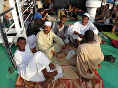 Friendly Sudanese men patiently waiting for sunset so they can break the fast during Ramadan; Wadi Halfa ferry