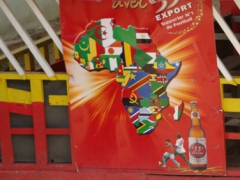 "Colorful ""33 Export"" beer sign; N'Dende"