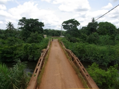 A 'sturdy' bridge takes us across the river; N'Dende