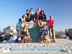 The girls strike a pose at Cape Agulhas, straddling the Indian and Atlantic oceans. From left to right, front to back: Marie, Sara, Norma, Becky, Bree, Kendra, Ruth, Katherine, Pam
