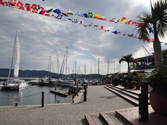 Colorful flags decorate the waterfront of pretty Knysna