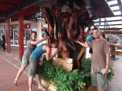 Bree, Luke and Robby strike a silly pose next to a wooden carving in Knysna