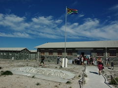 The South African flag proudly waves above Robben Island prison museum