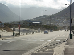 The sandy streets of Hout Bay as strong winds kick up the nearby sand dunes