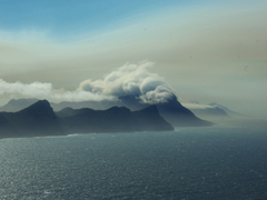 View of clouds bursting over mountain tops, as seen from Cape Point
