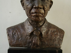 Bust of Nelson Rolihlahia Mandela at the entrance to the ferry terminal to Robben Island