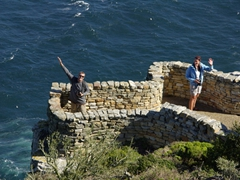 Robby and Bree wave from a lower section of Cape Point