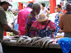 Early morning shoppers buying fresh fish at Sir Selwyn's Market, Victoria