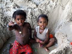 These kids playing in the sand are too cute!